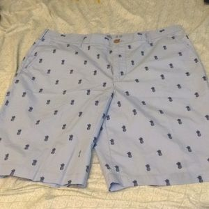 I'm selling light blue shorts with pineapples.